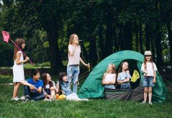 Group of teens camping in forest