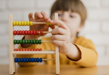 defocused-child-learning-how-count-using-abacus_23-2148524671