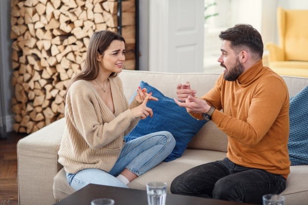 upset-couple-home-handsome-man-beautiful-young-woman-are-having-quarrel-sitting-sofa-together-family-problems_141188-3611