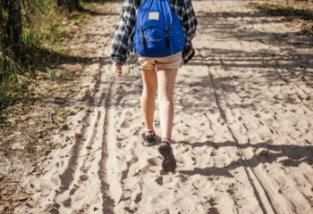 backpacker girl walk alone in pathway